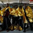 Migrants stand on the deck of Malta-based NGO Migrant Offshore Aid Station (MOAS) ship Phoenix after being rescued from a rubber dinghy in central Mediterranean on international waters some 15 nautical miles off the coast of Zawiya in Libya, April 14, 2017. REUTERS/Darrin Zammit Lupi