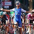 Colombia's Fernando Gaviria of team Quick-Step celebrates as he crosses the finish line of the 5th stage of the 100th Giro d'Italia, Tour of Italy, cycling race from Pedara to Messina on May 10, 2017 in Sicily.  Gaviria, of the Quick Step team, had taken the race lead by winning Sunday's third stage and achieved his second success in a sprint at the finish of the 159km ride from Pedara to Messina, Sicily. / AFP PHOTO / Luk BENIES