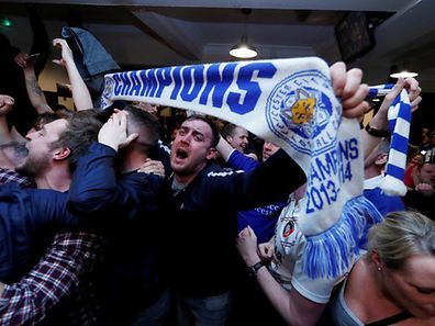 Leicester City fans watch the Chelsea v Tottenham Hotspur game in pub in Leicester