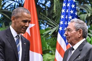 "TOPSHOT - US President Barack Obama (L) and Cuban President Raul Castro shake hands during a meeting at the Revolution Palace in Havana on March 21, 2016. Cuba's Communist President Raul Castro on Monday stood next to Barack Obama and hailed his opposition to a long-standing economic ""blockade,"" but said it would need to end before ties are fully normalized.   AFP PHOTO/Nicholas KAMM / AFP PHOTO / NICHOLAS KAMM"