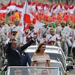 The presidential convoy, led by Brazil's President-elect Jair Bolsonaro (L) and his wife Michelle Bolsonaro in a Rolls Royce, heads to the National Congress for his swearing-in ceremony, in Brasilia on January 1, 2019. - Bolsonaro takes office with promises to radically change the path taken by Latin America's biggest country by trashing decades of centre-left policies. (Photo by Carl DE SOUZA / AFP)