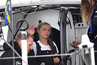 "Swedish climate activist Greta Thunberg, 16, arrives in the US after a 15-day journey crossing the Atlantic in the Malizia II, a zero-carbon yacht, on August 28, 2019 in New York. - ""Land!! The lights of Long Island and New York City ahead,"" she tweeted early Wednesday. She later wrote on Twitter that her yacht had anchored off the entertainment district of Coney Island in Brooklyn to clear customs and immigration. (Photo by Johannes EISELE / AFP)"