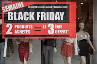 A picture shows a sign for Black Friday sales in a shop in Caen, northwestern France, on November 27, 2019. - Black Friday is a sales offer originating from the US where retailers slash prices on the day after the Thanksgiving holiday. (Photo by Sameer Al-DOUMY / AFP)